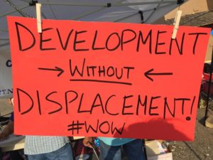 Sign that says Development without Displacement